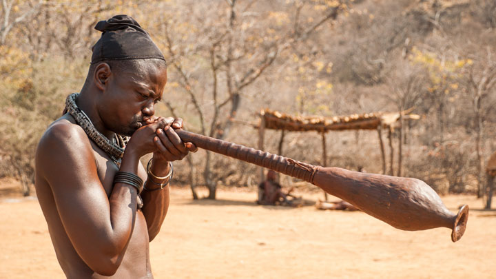 Playing the Ovahimba trumpet